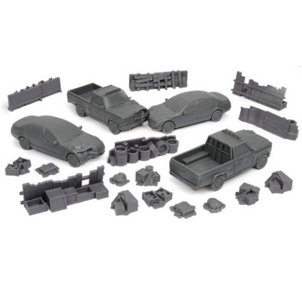 Alcuni degli elementi scenici aggiuntivi, come barricate e macchine distrutte, da usare nel gioco.