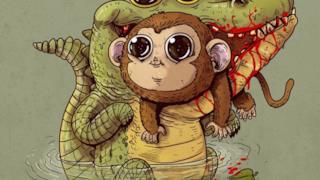 Una scimmia guarda negli occhi la morte, tra le grinfie di un coccodrillo