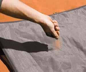 Il tappetino da spiaggia anti sabbia in azione