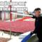 Foto di  Kim Jong-un davanti alla folla di seguaci