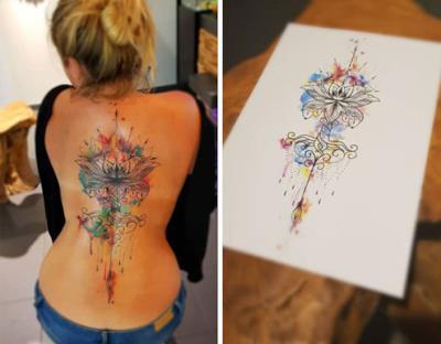un disegno astratto tatuato sulla schiena - Tatuaggi per la spina dorsale, i più belli per la tua schiena