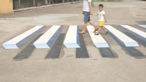 Disegni 3D sulle strade indiane