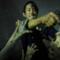 Glenn in un banner promozionale di The Walking Dead