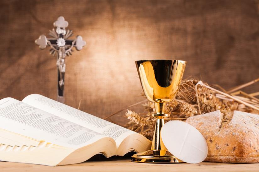 Bibbia con ostia e calice