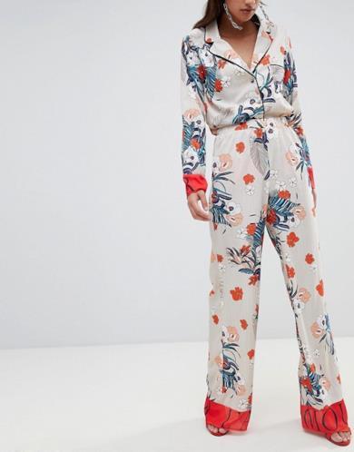 Pantaloni palazzo beige a fiori per donna