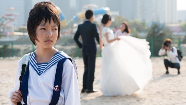 Gli angeli vestono di bianco, film Venezia 74