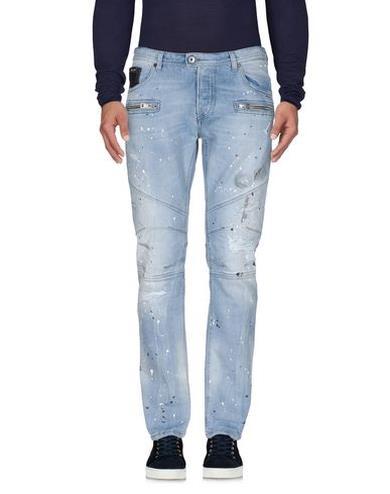 Jeans effetto macchiato con strappi