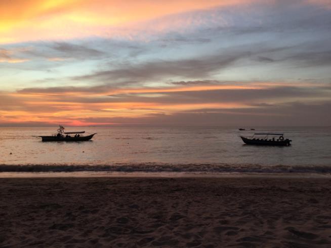 La spiaggia e il tramonto a Batu Ferringhi