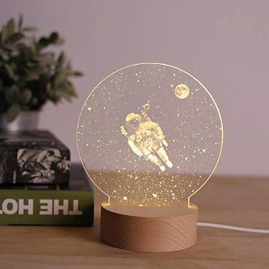Lampada da tavolo con astronauta