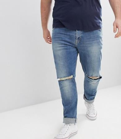 Jeans lavaggio medio con strappi alle ginocchia