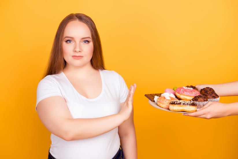 """Sovrappeso femminile: evitare """"junk food"""""""