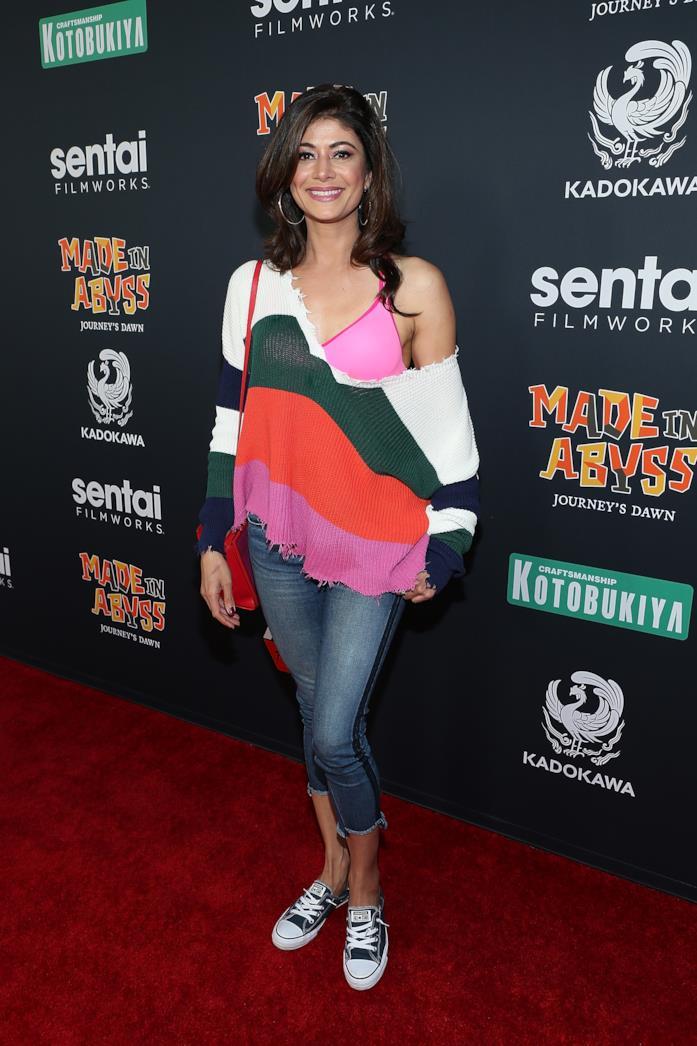 Outfit casual con jeans al polpaccio con maglia oversize a righe