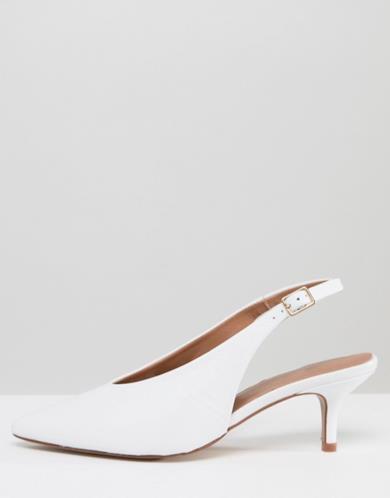 Scarpe a punta bianche in pelle con tacchetto a spillo