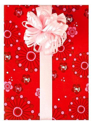 Pacchetto realizzato con il fiocco a fiore