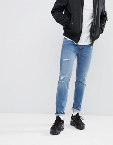 Jeans skinny blu elasticizzati effetto invecchiato