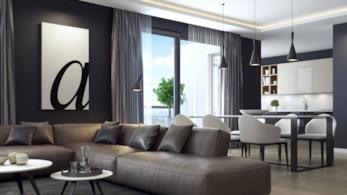 Zona giorno della casa arredata con mobili moderni neri e bianchi