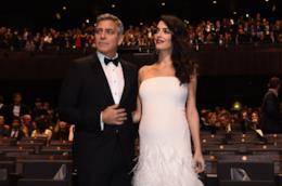 George Clooney e la moglie Amal Alamuddin a una première