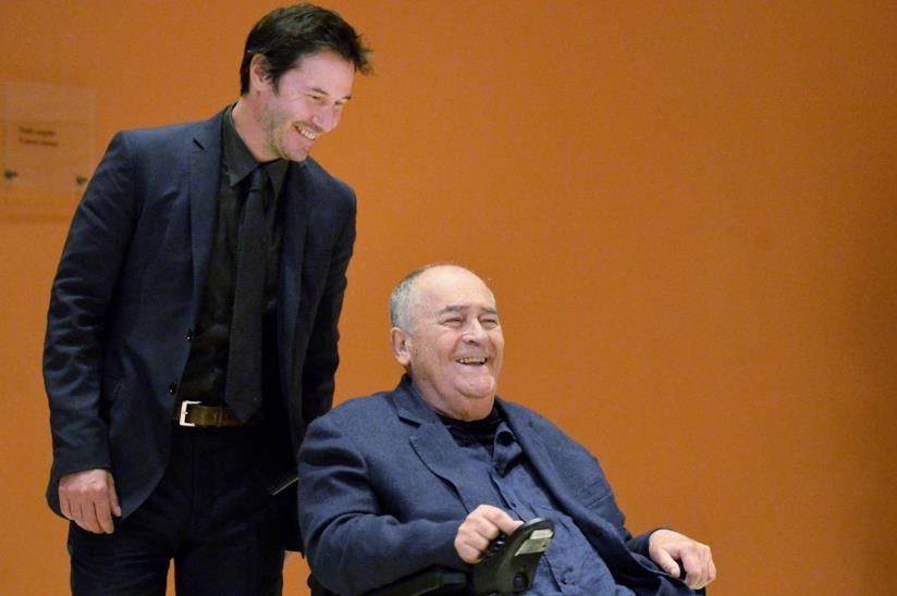 Bernardo Bertolucci con Keanu Reeves