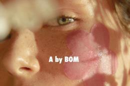 A. by BOM