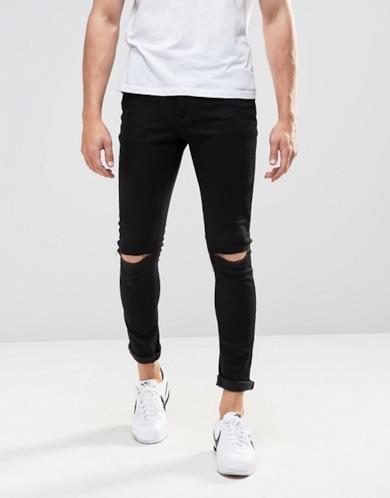 Jeans super skinny con strappi alle ginocchia