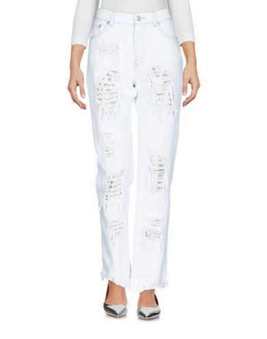 Jeans con strappi Versace