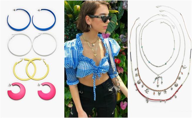 Dua Lipa punta sugli accessori e occhiali da sole cat-eye per il suo look e5eb25241d7
