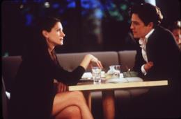 una scena di Notting Hill con Hugh Grant e Julia Roberts