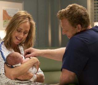 Teddy e Owen con la loro figlia neonata