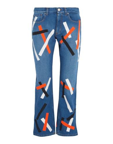 Jeans a zampa con applicazioni a contrasto