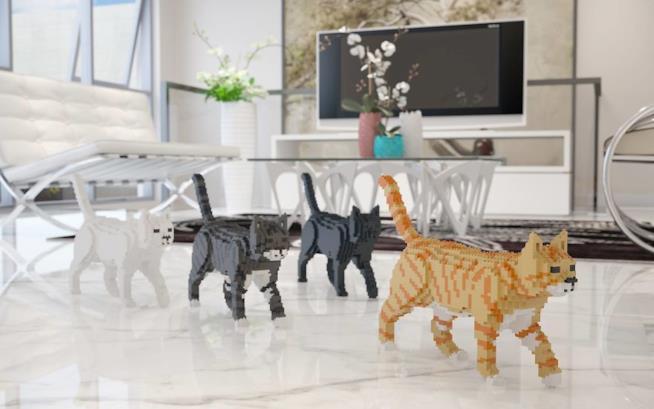 Sculture di gatti che camminano