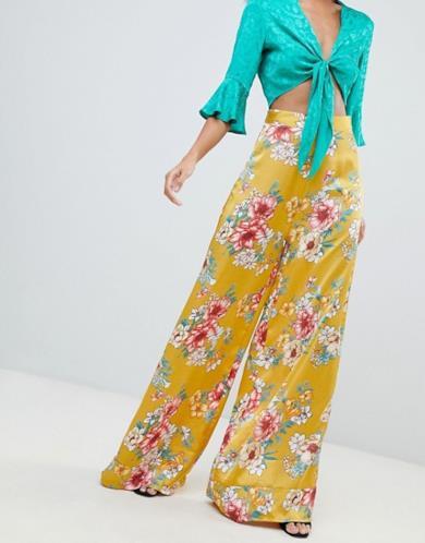 Pantaloni gialli palazzo a vita alta con stampa a fiori