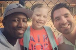 Due uomini ed il loro figlio adottivo