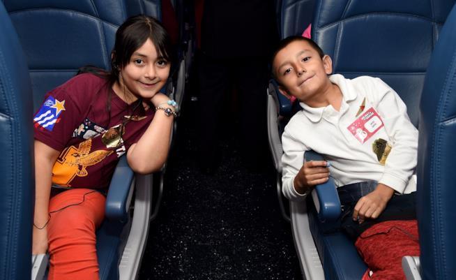 Come vestire i bambini in aereo