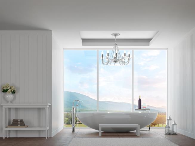 Bagno con vasca in superficie davanti a una vetrata