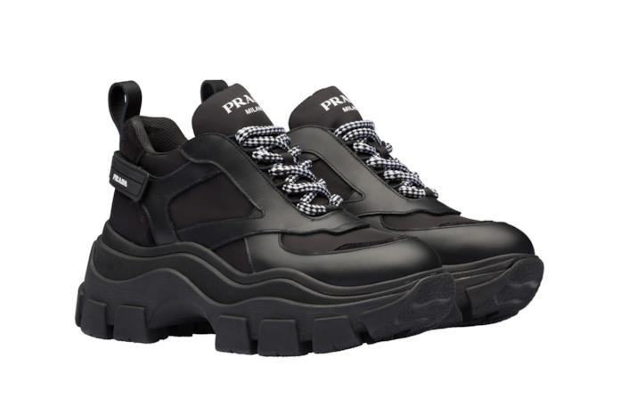 Chunky Sneakers nere in pelle con logo in bianco e lacci bianchi e neri