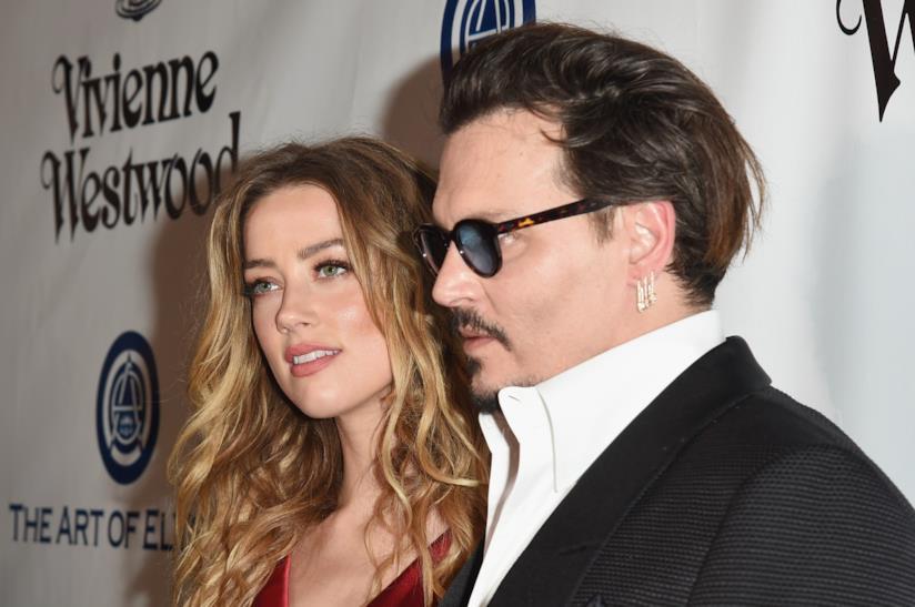 Johnny Depp con l'ex moglie Amber Heard