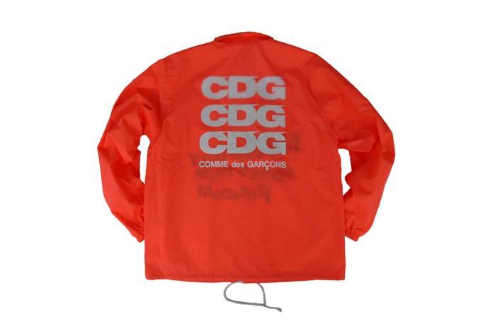 Parka arancio fluo con logo CDG