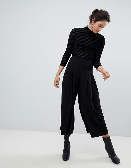 Pantaloni a palazzo neri corti e ampi da donna