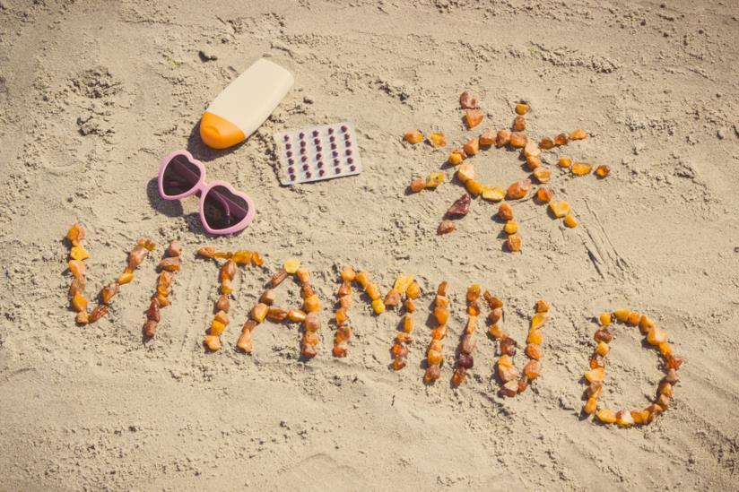 Vitamina D scritta sulla sabbia