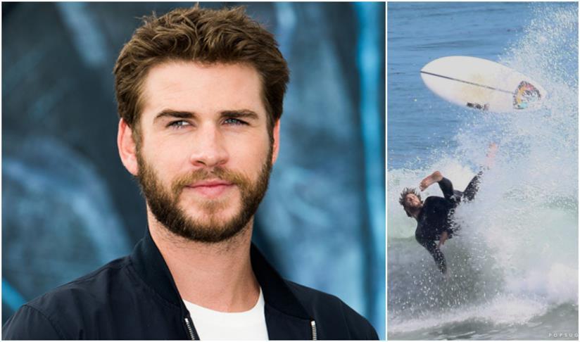 Liam Hemsworth durante il surf