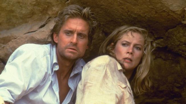 Michael Douglas e Kathleen Turner in All'inseguimento della Pietra Verde