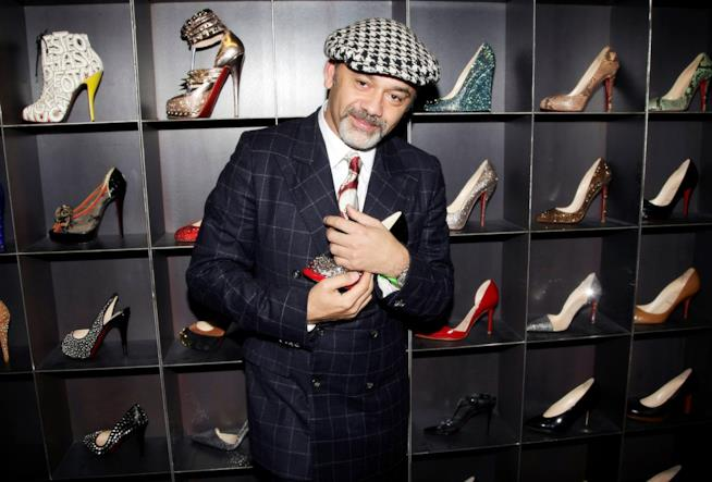 Christian Louboutin con le sue scarpe