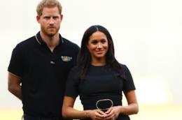 Il principe Harry con la moglie Meghan
