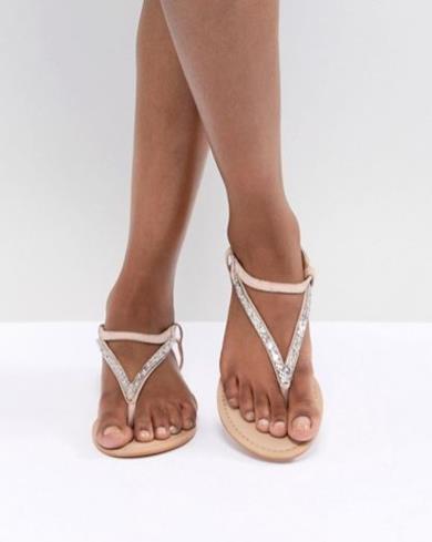 Sandali bassi decorati in pelle