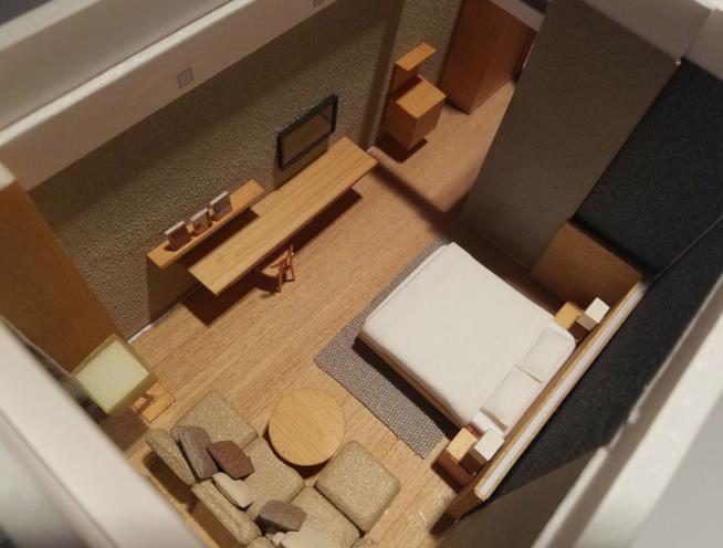 Modello tridimensionale in legno di una camera del nuovo hotel Muji a Shenzen