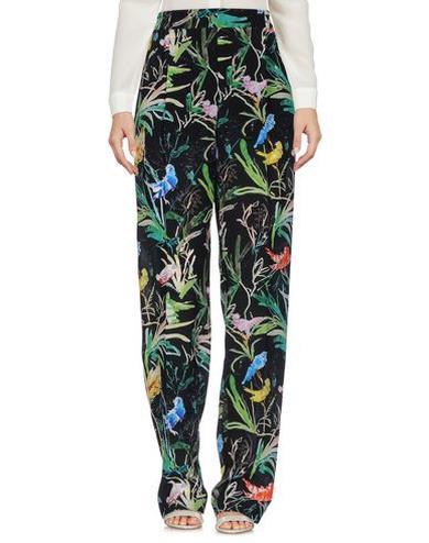 Pantaloni da donna modello a palazzo con fiori e uccellini
