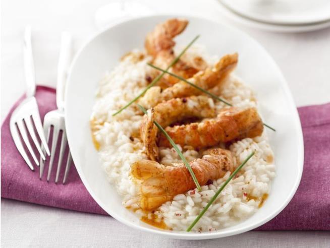 Primo piatto di riso e crostacei