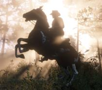 Un suggestivo tramonto a cavallo in Red Dead Redemption 2