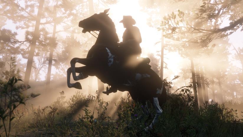 Un suggestivo tramonto a cavallo in Red Dead Redemption 2