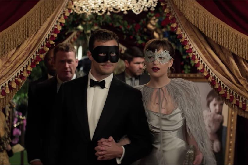 Anastasia e Christian al ballo in maschera in Cinquanta sfumature di Nero